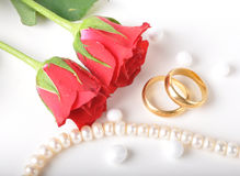 Wedding ring & rose Stock Image