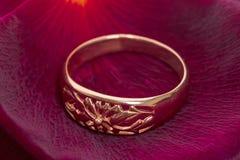 Wedding ring on a rose petal Stock Photo