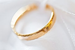 Wedding ring on a satiny fabric (macro) Royalty Free Stock Photos