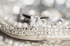 Wedding ring on sequins and pearls Stock Photo