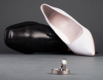 Wedding ring and shoes Royalty Free Stock Images