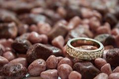 Wedding ring on the stones Stock Photo