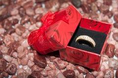 Wedding ring on the stones Stock Image