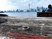 Wedding ring on a table facing the Toronto skyline royalty free stock image