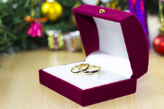 Wedding ring under the christmass tree Royalty Free Stock Photography