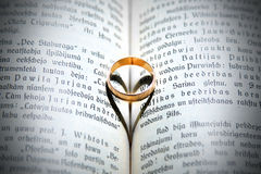 Wedding ring on vintage book. Heart Stock Photography