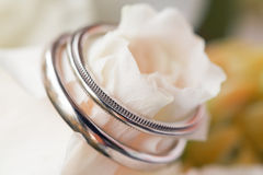 Wedding ring with white roses Stock Photos