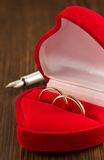 Wedding ring on wood Royalty Free Stock Image