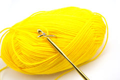 Wedding ring in yellow knitting isolated on white background Royalty Free Stock Photos