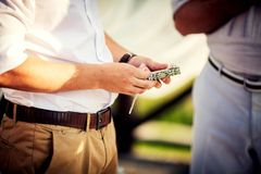 Wedding ring in the young groom Royalty Free Stock Photo