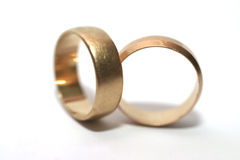 Wedding rings. Two gold wedding rings, shallow DOF stock photography