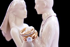 Wedding Rings. Wedding bands on statuettes stock image