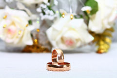Wedding rings. Two couple gold wedding rings and rose Royalty Free Stock Image