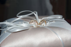 Wedding rings. On a white ring-bearer's pillow Stock Photography