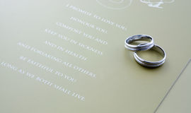 Wedding rings. A pair of wedding rings with wedding vows Stock Images