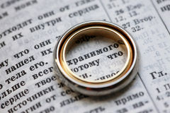 Wedding rings. And the bible in Russian Stock Photography