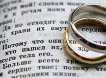 Wedding rings. And the bible in Russian Royalty Free Stock Image