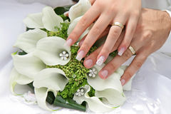Wedding rings. On hand of bride and groom Stock Images
