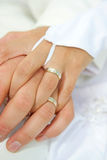 Wedding rings. On hand of bride and groom Stock Photo