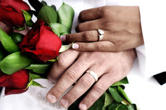 Wedding rings. A couple showing off their wedding rings Stock Image