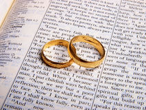 Wedding rings. On a bible. Close up Royalty Free Stock Images