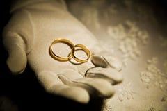 Wedding Rings. Bride is holding golden wedding rings Stock Photo