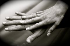 Wedding rings. On newlyweds hands stock photos