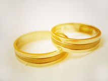 Wedding rings. Two wedding rings on the off-white background Royalty Free Stock Image