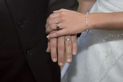 Wedding Rings. Bride and Groom holding hands showing their wedding rings Stock Photo