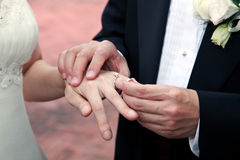 Wedding rings. Being exchanged during a ceremony Royalty Free Stock Images