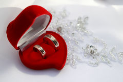 Wedding Rings. And red heart on wedding dress Royalty Free Stock Photo