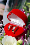 Wedding Rings. And red heart with flowers Royalty Free Stock Images