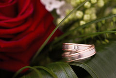 Wedding rings. Two wedding rings perched on Wedding Bouquet Royalty Free Stock Image