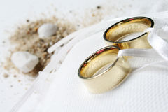Wedding rings. Two wedding rings and some sand Royalty Free Stock Photography