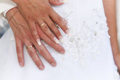 Wedding rings. Bride and groom holding their hands with wedding rings together Stock Images