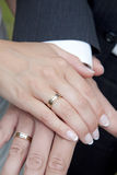 Wedding rings. Newly wed couple showing their wedding rings Stock Images