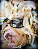 Wedding rings. His and hers wedding rings in bouquet of  rose flowers Stock Photography