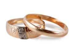 Wedding rings. A pair of wedding rings (male and female) isolated over white background Stock Image