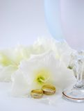 Wedding rings. With flower and glass Royalty Free Stock Image