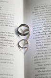 Wedding Rings. Casting shadow on book Royalty Free Stock Photos