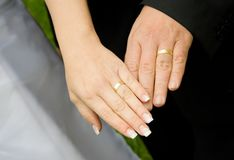 Wedding rings. Married pair showing their wedding rings on hands Stock Images