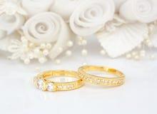 Wedding rings. Gold wedding rings on flowers background Stock Image