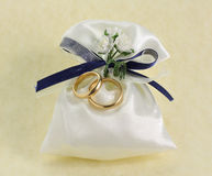 Wedding rings. On bonbonniere isolated Stock Images