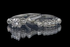 Wedding rings 2. Close up of wedding and engagement rings on reflective surface Royalty Free Stock Photos