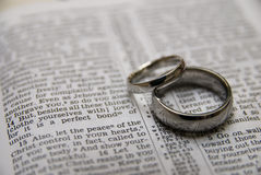 Wedding rings. Male and Female wedding rings placed on a bible Royalty Free Stock Photography