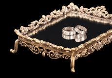 Wedding rings. On a vintage mirror tray isolated on black background Royalty Free Stock Image