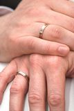 Wedding rings. Two hands of a married couple with wedding rings Stock Photos