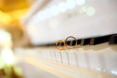 Wedding rings. On the piano keys Stock Photo