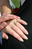 Wedding rings. Bride and groom and wedding rings Royalty Free Stock Photo