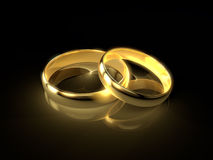 Wedding rings. Two golden wedding rings  on black background Stock Photography